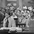 """1 - comme la place du personnage d'Atticus Finch interprété par Gregory Peck dans """"Du silence et des ombres"""", au classement des 100 plus grands héros de films par L'American Film Institute"""